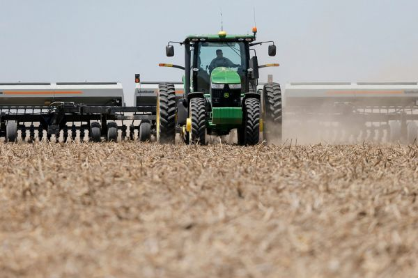 A farmer plants sorghum on his farm in Stanton County, Kansas