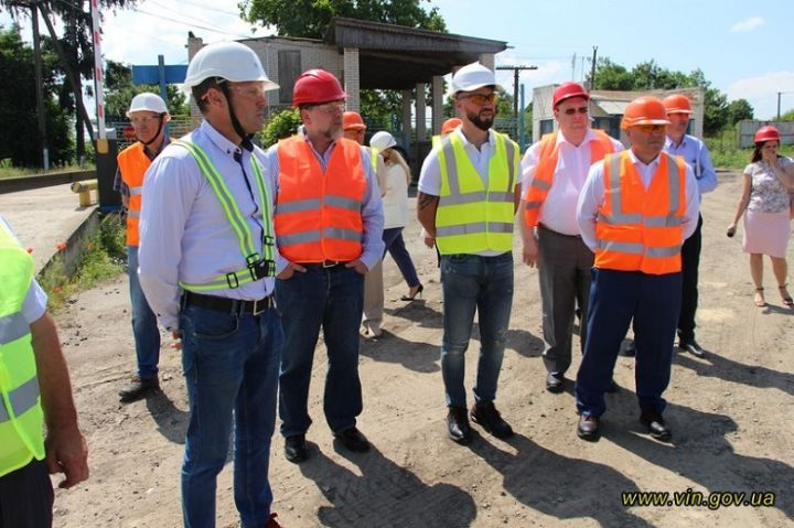 Companies' officials at the mill construction site