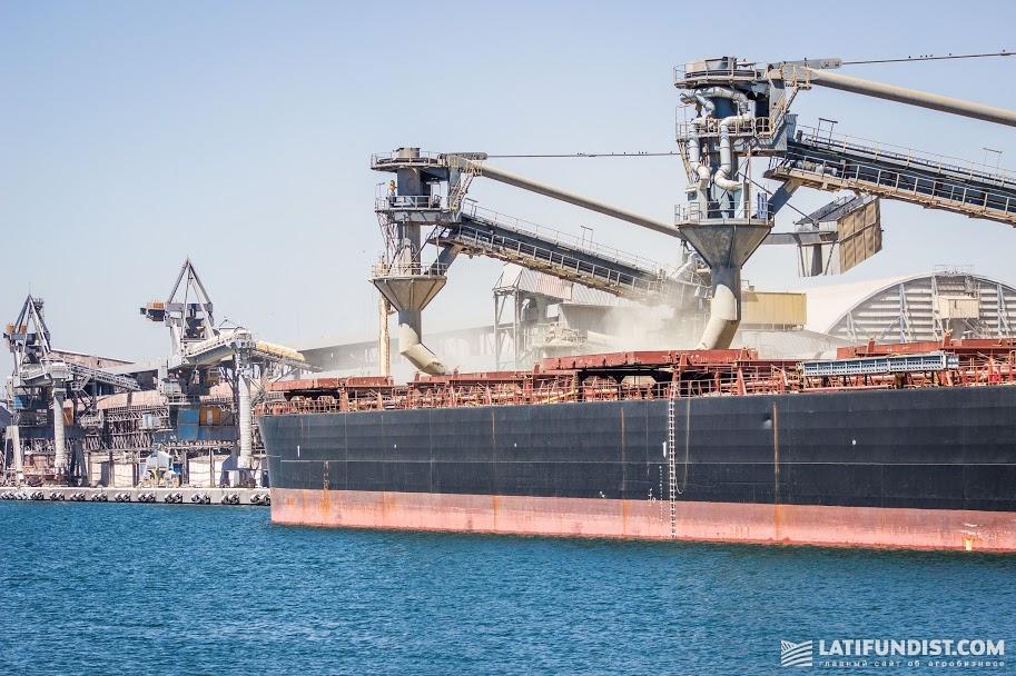 Grain shipment on the vessel in the port of Pivdenny (Odesa region, Ukraine)